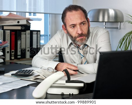 Mature businessman calculating finance. Horizontal shot - stock photo