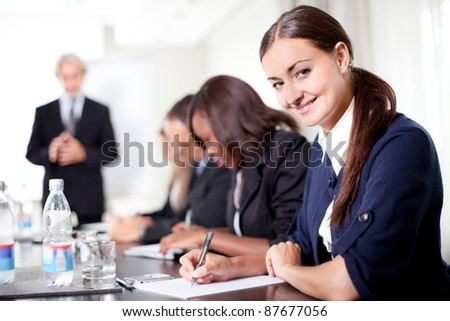 Mature businessman conducting training professionals taking notes - stock photo