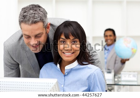 Mature businessman helping his colleague in the office