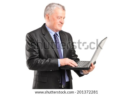 Mature businessman holding a laptop isolated on white background