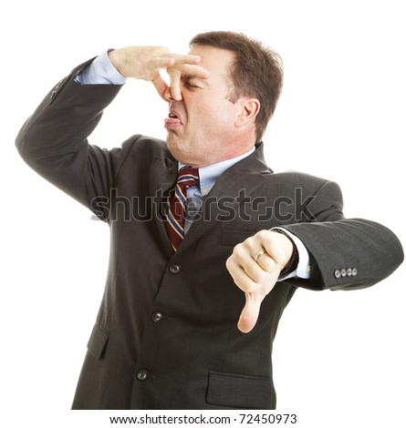 Mature businessman holds his nose and gives a thumbs-down.  Isolated on white. - stock photo