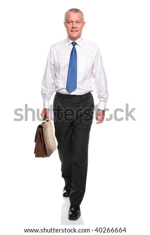 Mature businessman in shirt and tie walking towards carrying a briefcase, isolated on a white background. - stock photo