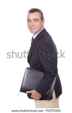 Mature businessman looking back - stock photo
