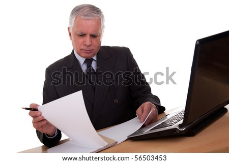 mature businessman  looking to computer, isolated on white background. Studio shot. - stock photo