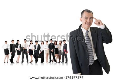 Mature businessman of Asian got an idea and standing in front of his team on studio white background.