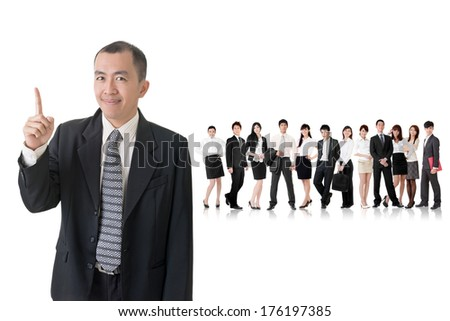 Mature businessman of Asian got an idea and standing in front of his team on studio white background. - stock photo