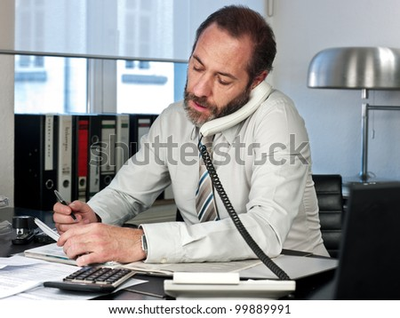 Mature businessman on the phone. Horizontal shot