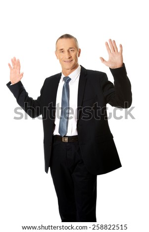 Mature businessman pressing abstract screen.