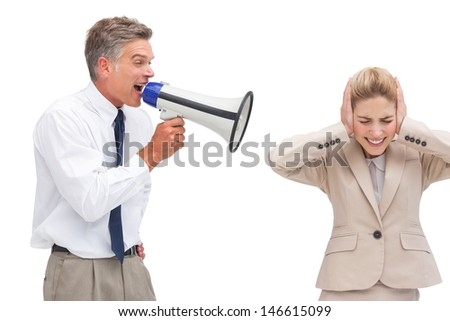 Mature businessman shouting at his coworker with megaphone on white background