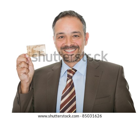 Mature businessman showing a credit card - stock photo