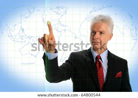 Mature businessman using touch screen interface with world map