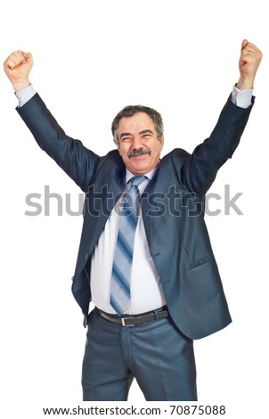 Mature businessman with success in business raising arms and smiling isolated on white background - stock photo