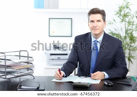 Mature businessman working in the office - stock photo