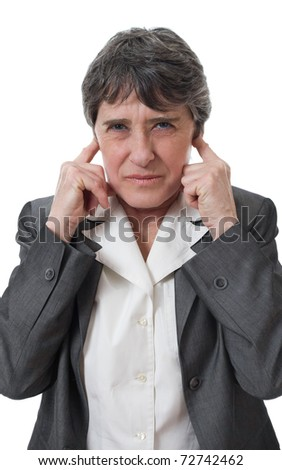 mature businesswoman closing ears with her fingers isolated on white background - stock photo