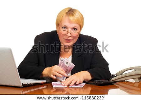 Mature businesswoman counting the money. Isolated against white background.