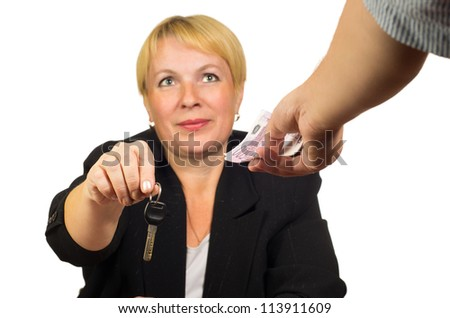 Mature businesswoman gives the keys for the money. Isolated against white background.
