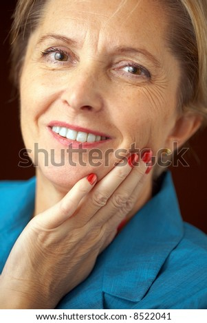 Mature businesswoman looking at camera. - stock photo