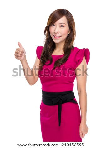 Mature businesswoman thumb up