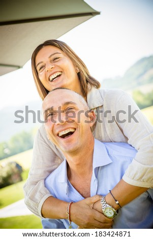 mature caucasian couple embracing -Italy - stock photo