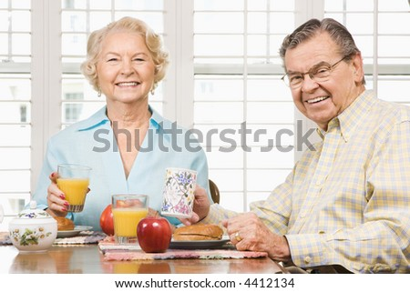 Mature Caucasian couple having breakfast together.