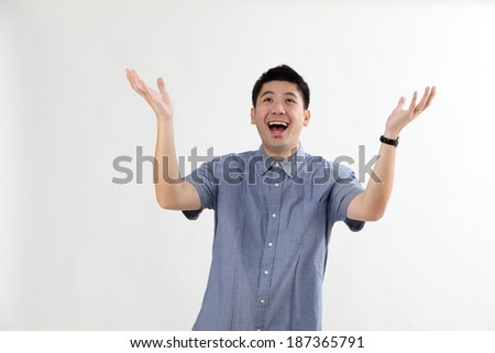 Mature chinese man with surprise expression - stock photo