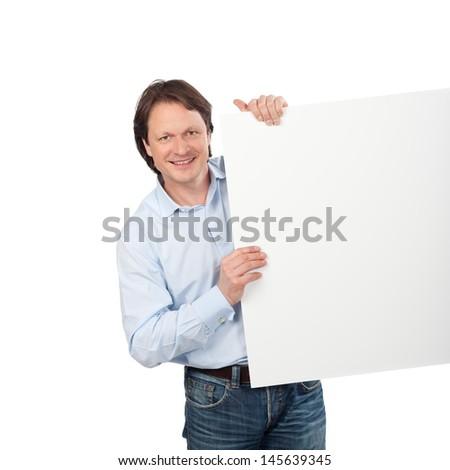 mature confident man showing empty white board - stock photo