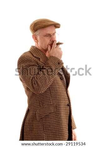 Mature country gent in tweeds with a cigar - stock photo