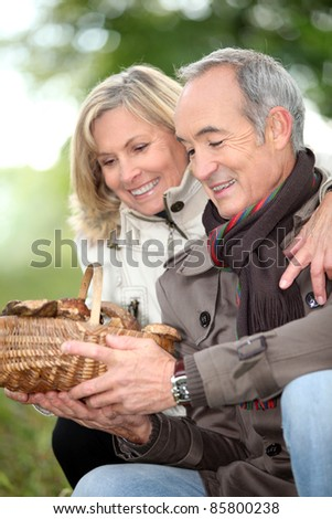 mature couple after ramble in the woods