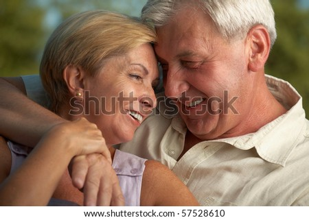 Mature couple being happy together - stock photo