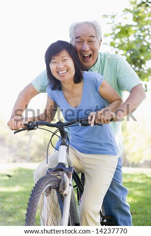 Mature couple bike riding.