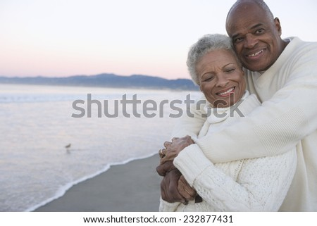 Mature Couple by the Sea - stock photo