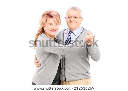 Mature couple dancing tango isolated on white background - stock photo