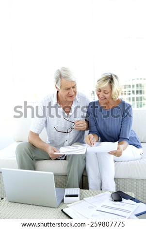 Mature couple doing Home Finance - stock photo