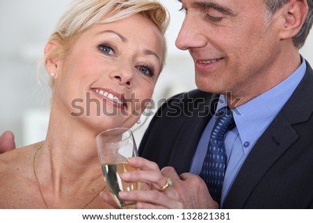 Mature couple drinking champagne - stock photo