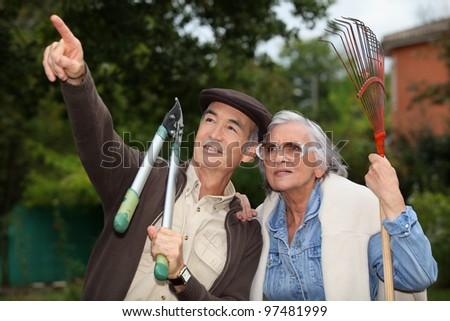 mature couple gardening - stock photo