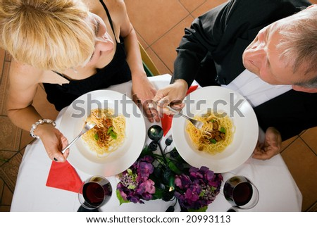 Mature couple having a romantic dinner still being in love after all those years - stock photo