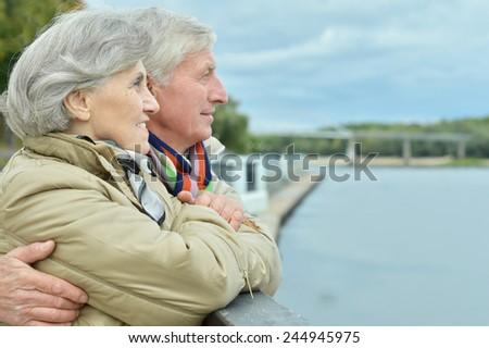 Mature couple having fun in the autumn park - stock photo