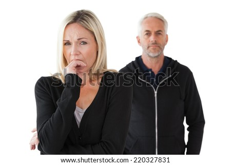 Mature couple having relationship problems over white background - stock photo