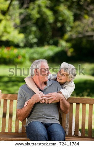 Mature couple hugging in the garden - stock photo