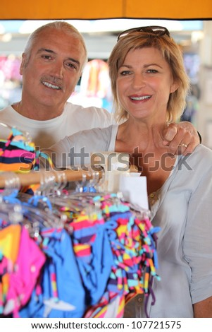 Mature couple in a store - stock photo