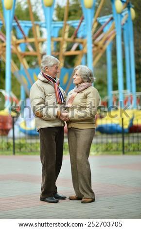 Mature couple in  autumn park - stock photo