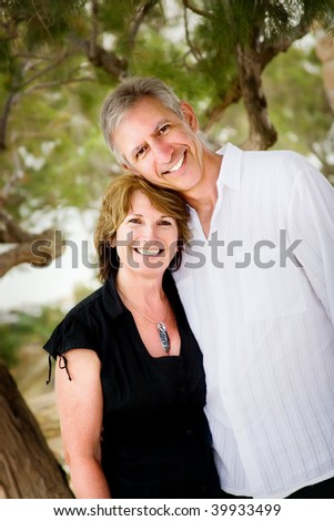 Mature couple in love looking relaxed and happy - stock photo