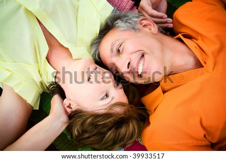 Mature couple in love looking relaxed and happy