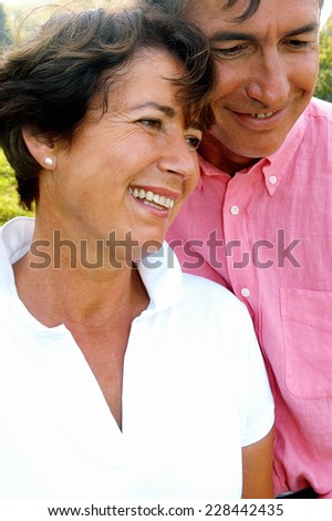 Mature couple in park - stock photo