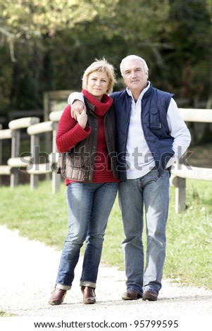 Mature couple in the country - stock photo