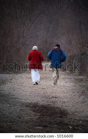 mature couple jogging on path