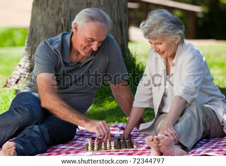 Mature couple  picnicking in the garden - stock photo