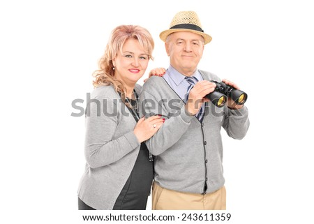 Mature couple posing with binoculars isolated on white background - stock photo