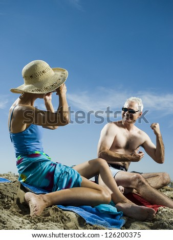 Mature couple relaxing at the beach - stock photo