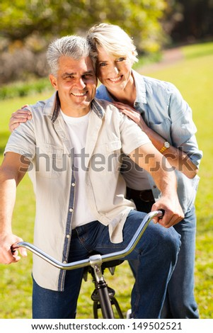 mature couple riding bike  outdoors